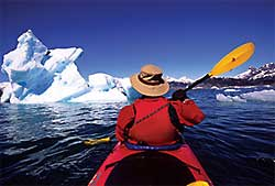 Photographer Kerrick James kayaks in the Columbia Glacier  forebay in Prince William Sound, Alaska. Every summer James makes the trip to photograph the exotic landscapes, towering mountains and unique aquatic life and tundra animals of the Alaskan ecosystem.