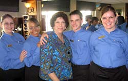 Linda with dining room staff of the Spirit of Discovery