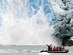 Zodiac experiencing a calving glacier upclose.