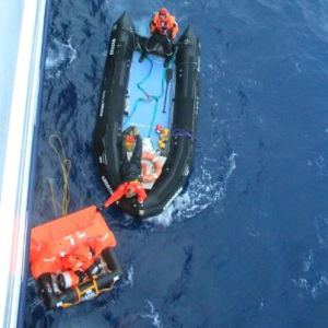 Crew members from the Orion rescue a sailor adrift in the Southern Ocean near Antarctica